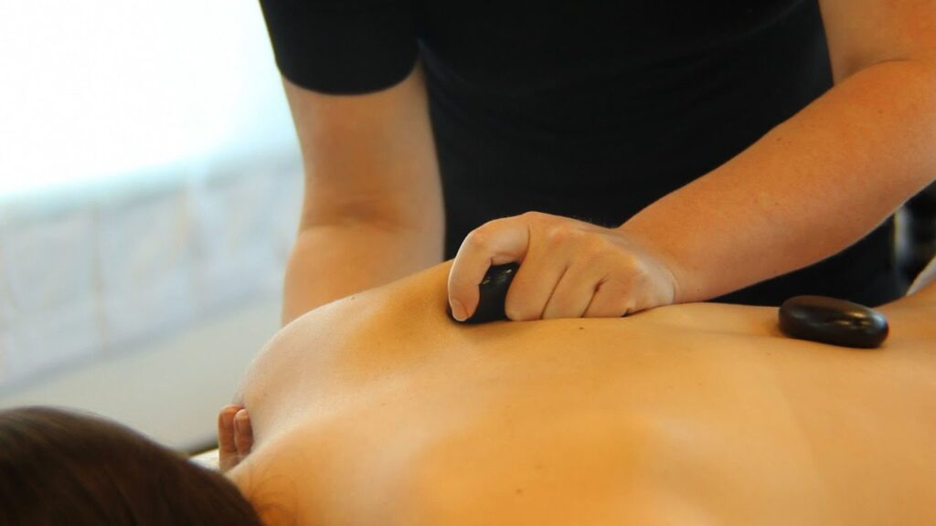 MassagEric Hands putting stones on back
