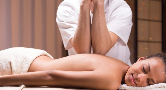 An image of a woman receving a massage