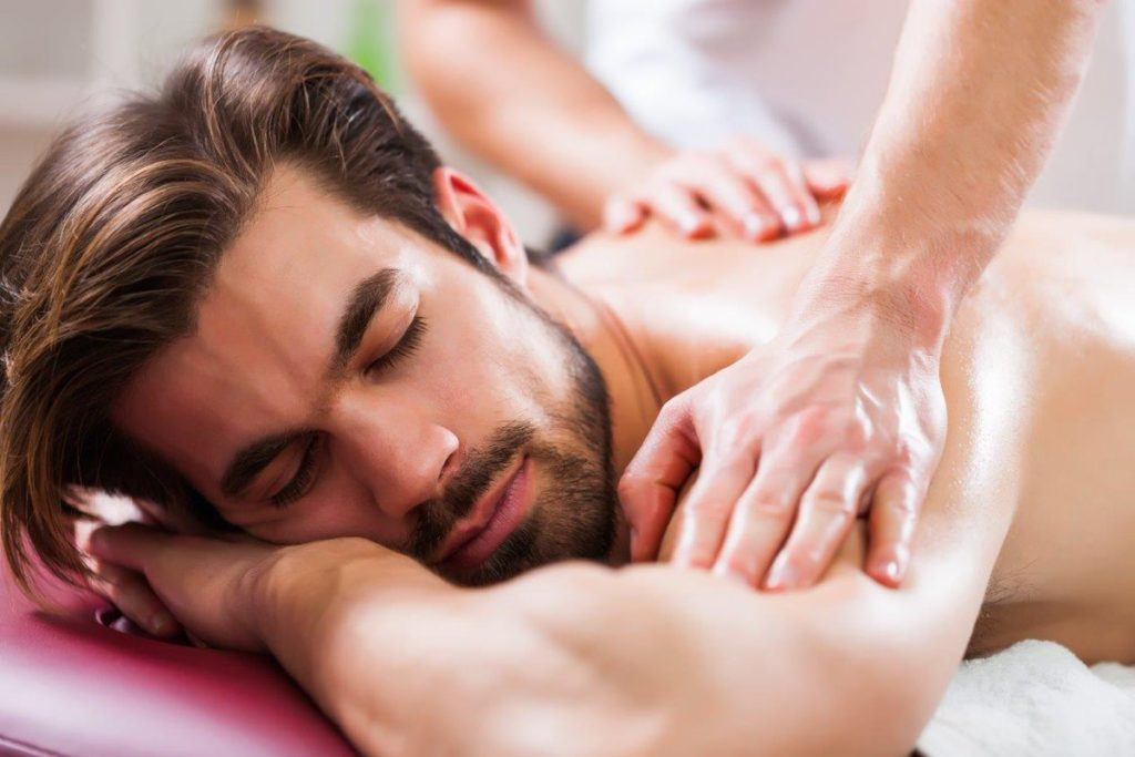 An image of a man receving a massage